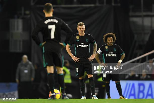 Cristiano Ronaldo Toni Kroos Marcelo of Real Madrid reacts during the La Liga match between RC Celta de Vigo and Real Madrid at Municipal Balaidos on...