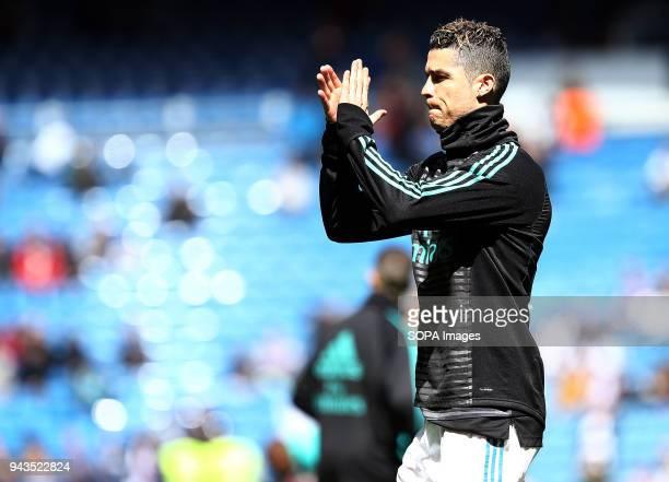 Cristiano Ronaldo warms up before the La Liga match between Real Madrid and Atletico de Madrid FC at Estadio Santiago Bernabeu. .