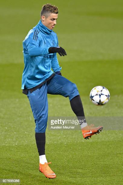 Cristiano Ronaldo warms up during a Real Madrid training session ahead of the Champion's League match against Paris SaintGermain at Parc des Princes...