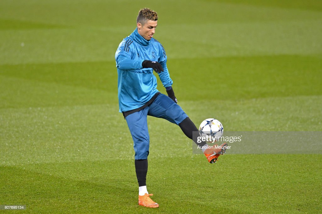 Cristiano Ronaldo warms up during a Real Madrid training session ahead of the Champion's League match against Paris Saint-Germain at Parc des Princes on March 5, 2018 in Paris, France.