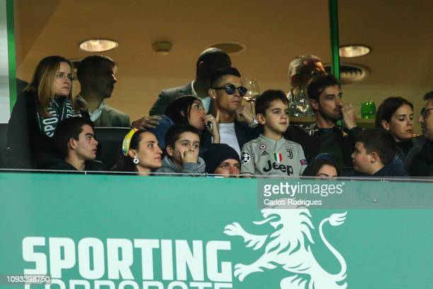 Cristiano Ronaldo watches his former team with his girlfriend Georgina Rodriguez the Liga NOS match between Sporting CP and SL Benfica at Estadio...