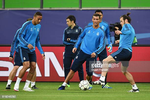 Cristiano Ronaldo watches team mate Gareth Bale during a Real Madrid training session ahead of their UEFA Champions League quarter final first leg...