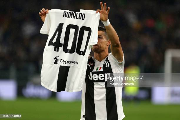 Cristiano Ronaldo with a celebratory shirt for his 400 goals across the Serie A Premier League and the La Liga before the Serie A match between...