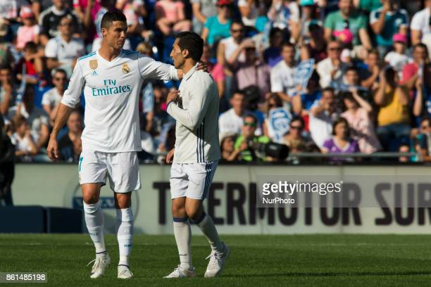 Cristiano Ronaldo with a follower who jumped to the pitch during the match between Getafe CF vs Real Madrid week 8 of La Liga 2017/18 in Coliseum...