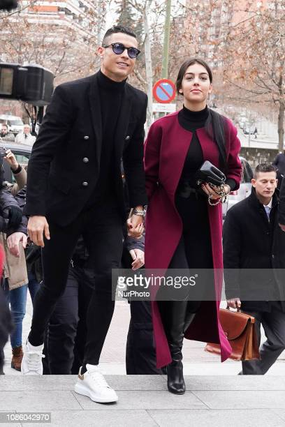 Cristiano Ronaldo with his girlfriend Georgina Rodriguez to attend a court hearing for tax evasion at Audiencia Provincial on January 22 2019 in...