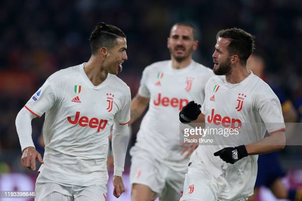 Cristiano Ronaldo with his teammate Miralem Pjanic of Juventus celebrates after scoring the team's second goal from penalty spot during the Serie A...