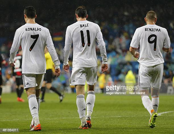 Cristiano Ronaldom Gareth Bale and Karim Benzema of Real Madrid walk back to the centre circle after their team's fourth goal during the La Liga...