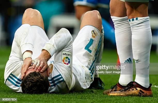 Cristiano Ronaldoof Real Madrid lies injured on the pitch during the La Liga match between Real Madrid and Deportivo de La Coruna at Estadio Santiago...