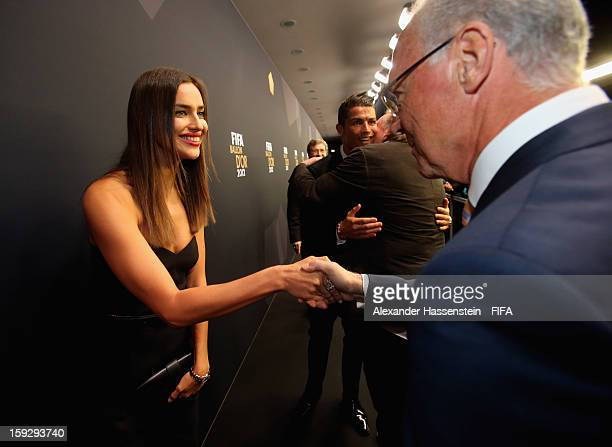 Cristiano Ronaldo's girlfriend Irina Shayk is greeted by Franz Beckenbaur during the red carpet arrivals at the FIFA Ballon d'Or Gala 2012 at the...