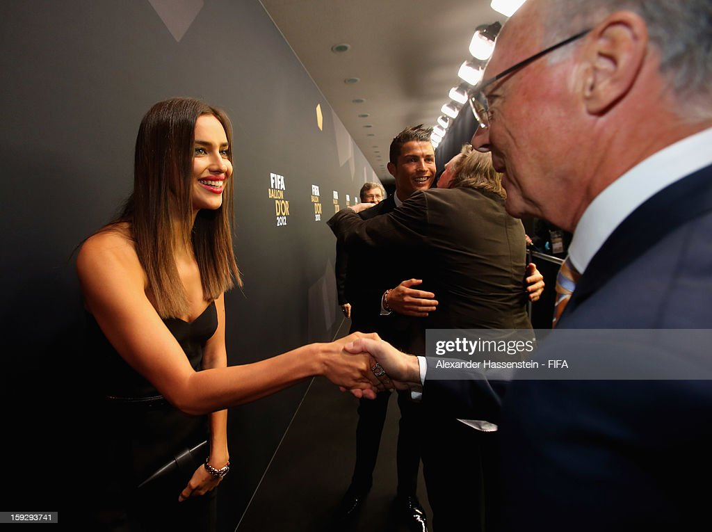 Cristiano Ronaldo's girlfriend Irina Shayk is greeted by Franz Beckenbaur during the red carpet arrivals at the FIFA Ballon d'Or Gala 2012 at the Kongresshaus on January 7, 2013 in Zurich, Switzerland.