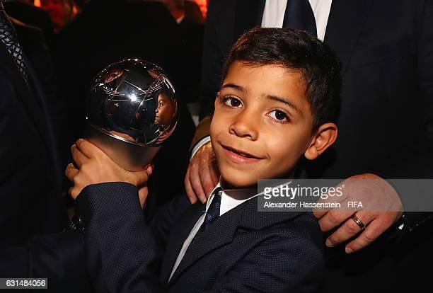 Cristiano Ronaldo's son Cristiano Ronaldo Junior poses with The Best FIFA Men's Player Award during The Best FIFA Football Awards at TPC Studio on...