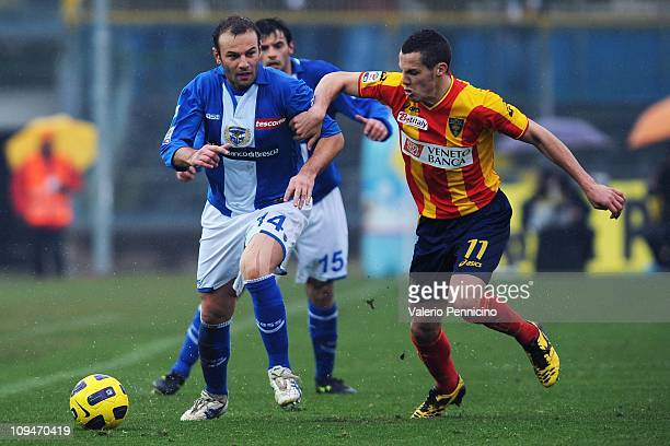 Cristiano Zanetti of Brescia Calcio is challenged by Djamel Mesbah of Lecce during the Serie A match between Brescia Calcio and Lecce at Mario...