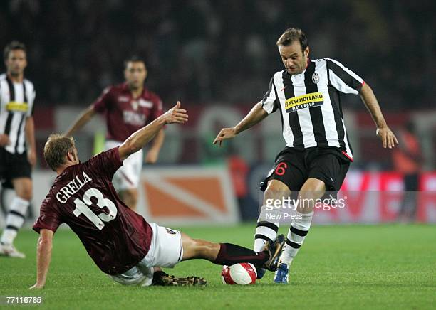 Cristiano Zanetti of Juventus is tackled by Vince Grella of Torino during the Serie A match between Juventus and Torino at the Stadio Olimpico di...