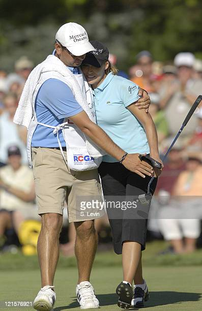 Cristie Kerr and her caddie after her final shot of the Canadian Women's Open at the London Hunt and Country Club in London Ontario on August 13 2006