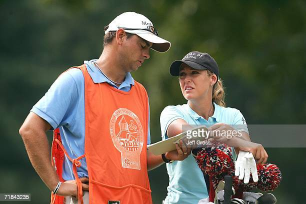 Cristie Kerr and her caddie Jason Gilroyed discuss a tee shot on the thirteenth hole during the final round of the John Q Hammons Hotel Classic on...