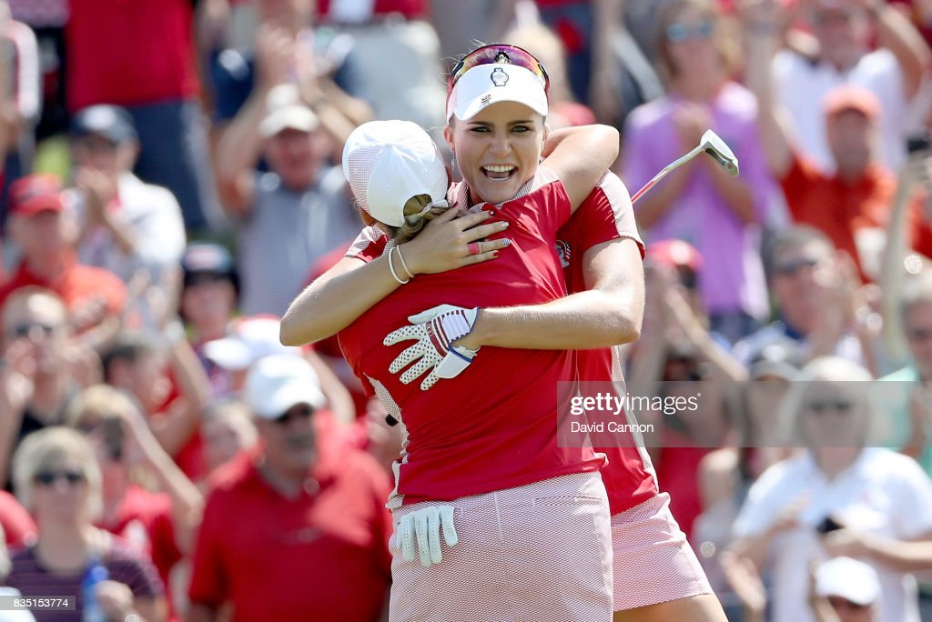 Cristie Kerr and Lexi Thompson of the United States Team Team celebrate after securing a half point on the 18th hole in their match against Charley Hull and Melissa Reid of the European Team during the morning foursomes matches in the 2017 Solheim Cup at Des Moines Golf Coutry Club on August 18, 2017 in West Des Moines, Iowa.