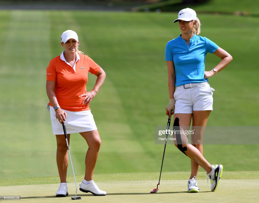 Cristie Kerr and Michelle Wie wait to putt on the ninth green during the second round of the LPGA LOTTE Championship at the Ko Olina Golf Club on April 12, 2018 in Kapolei, Hawaii.