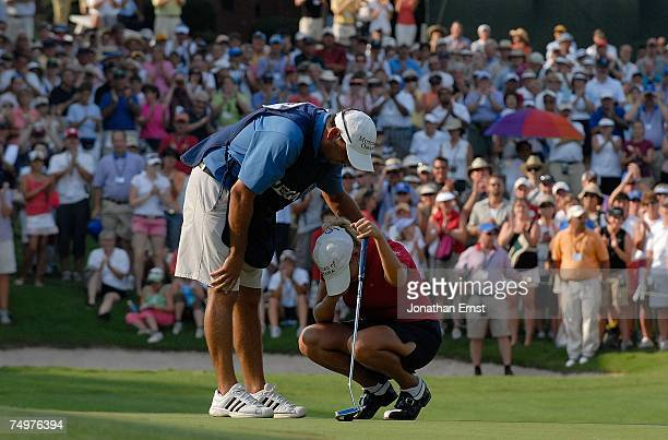 Cristie Kerr breaks down after her twostroke victory as her caddie Jason Gilroyed looks on at the US Women's Open Championship at Pine Needles Lodge...