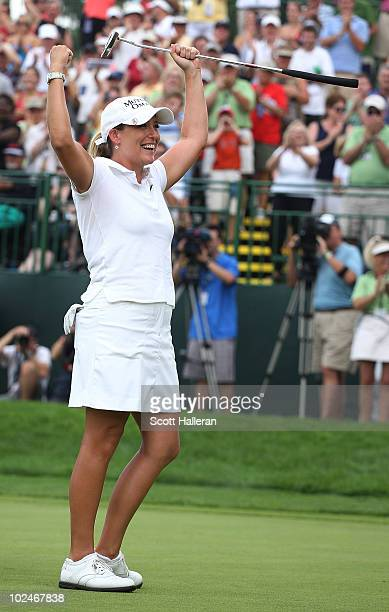 Cristie Kerr celebrates her 12-stroke victory on the 18th green after winning the LPGA Championship presented by Wegmans 2010 at the Locust Hill...