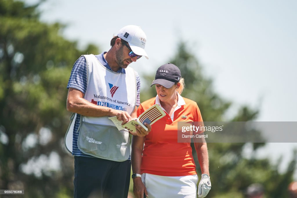 Cristie Kerr discusses her tee shot at the third hole with her caddie during the continuation of the first round of the 2018 Volunteers of America LPGA Texas Classic at Old American Golf Club on May 5, 2018 in The Colony, Texas.