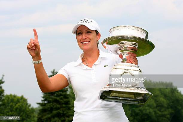Cristie Kerr holds the championship trophy after winning the LPGA Championship presented by Wegmans at Locust Hill Country Club on June 27 2010 in...