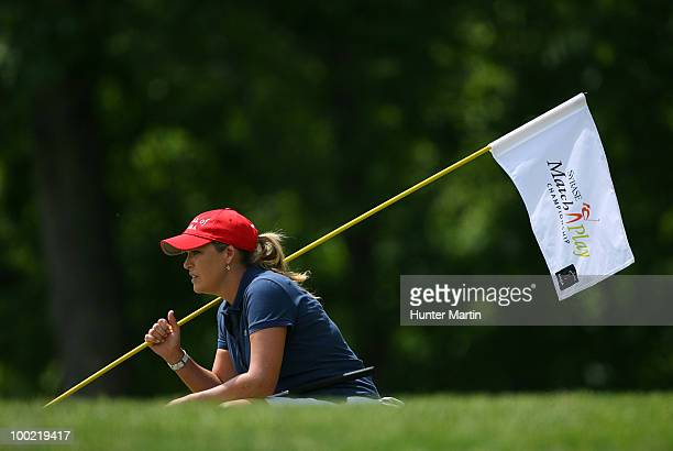 Cristie Kerr holds the flagstick as she lines up her putt on the fifth hole during the second round of the Sybase Match Play Championship at Hamilton...