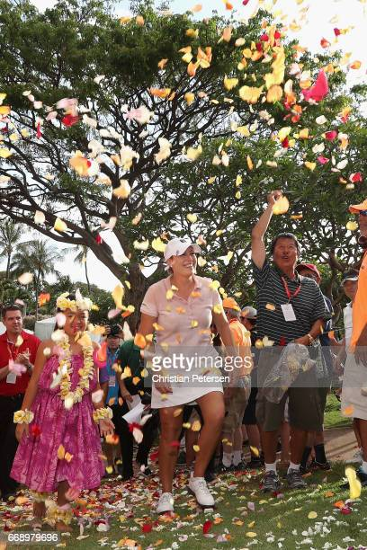 Cristie Kerr is showered with flowers petals after winning the LPGA LOTTE Championship Presented By Hershey at Ko Olina Golf Club on April 15 2017 in...
