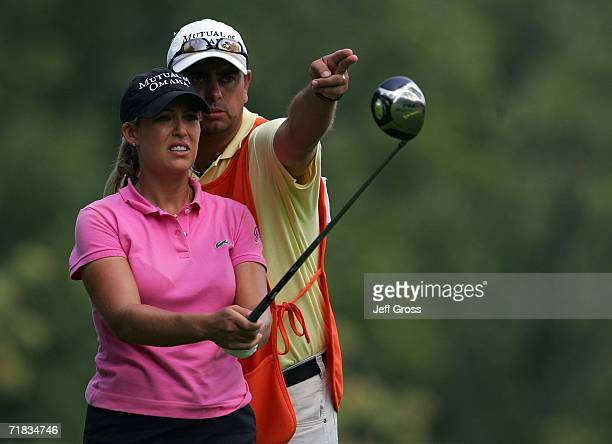 Cristie Kerr lines up a tee shot with her caddie Jason Gilroyed on the twelfth hole during the second round of the John Q Hammons Hotel Classic on...