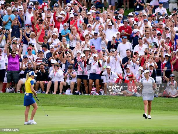 Cristie Kerr of Team USA celebrates her putt to win five and three in front of Jodi Ewart Shadoff of Team Europe on the 15th green during the morning...