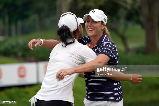Cristie Kerr of the United States celebrates with her compatriot Danielle Kang after a birdie on the 18th hole during day four of the Sime Darby LPGA...