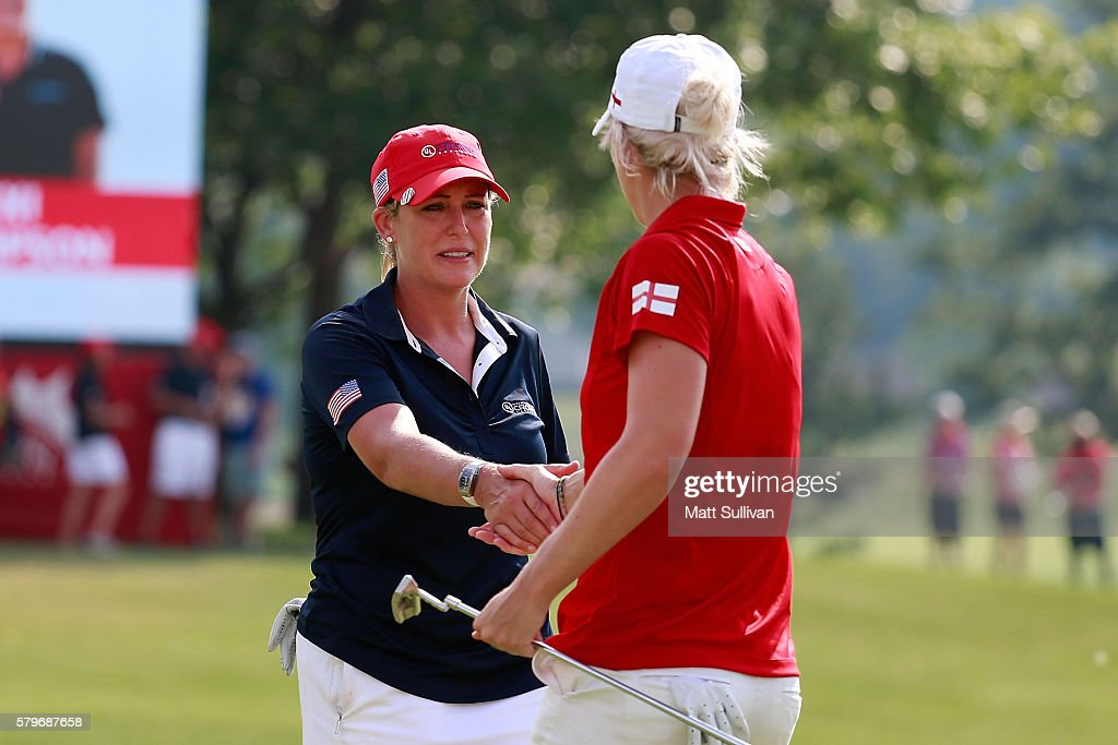 Cristie Kerr of the United States shakes hands with Melissa Reid of England following their singles matches of the 2016 UL International Crown at the Merit Club on July 24, 2016 in Chicago, Illinois.