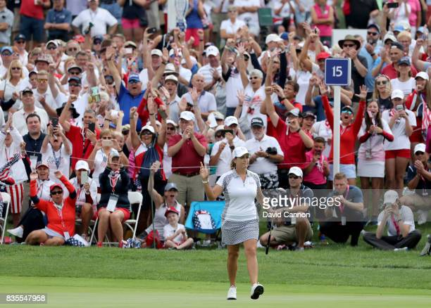 Cristie Kerr of the United States Team celebrates holing the match winning putt on the 15th hole in her match with Lexi Thompson against Jodi Ewart...