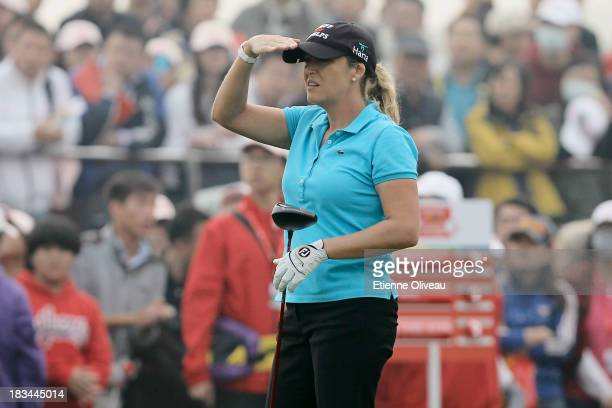 Cristie Kerr of the United States watches her ball after teeing off during the final round of the Reignwood LPGA Classic at Pine Valley Golf Club on...