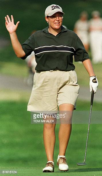 Cristie Kerr of the US waves to the crowd as she walks onto the 18th green in the third round of the LPGA Championship at the DuPont Country Club 26...