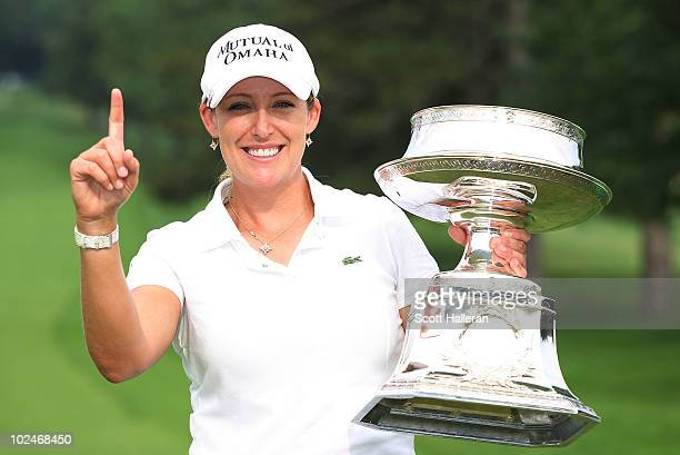 Cristie Kerr poses with the trophy after her 12-stroke victory at the LPGA Championship presented by Wegmans 2010 at the Locust Hill Country Club on...