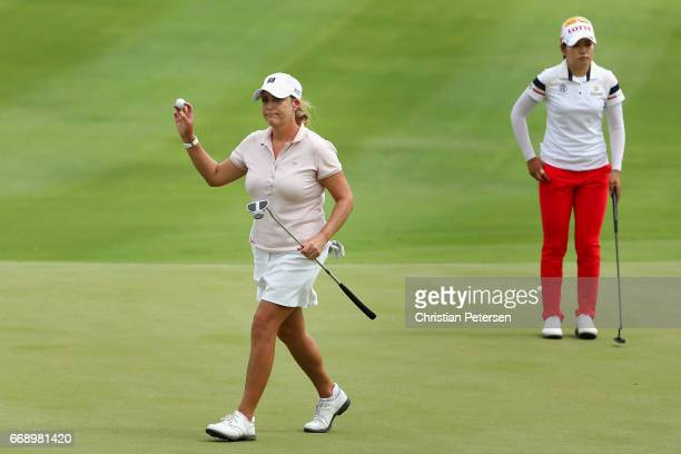 Cristie Kerr reacts to a par putt on the ninth green alongside SuYeon Jang of Republic of Korea during the final round of the LPGA LOTTE Championship...