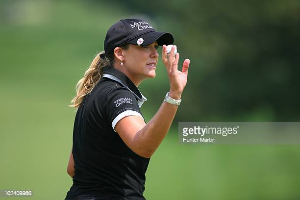 Cristie Kerr waves to the crowd after finishing her round on the 18th hole during the second round of the LPGA Championship presented by Wegmans at...