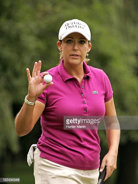 Cristie Kerr waves to the crowd after making birdie on the fourth hole during the third round of the LPGA Championship presented by Wegmans at Locust...