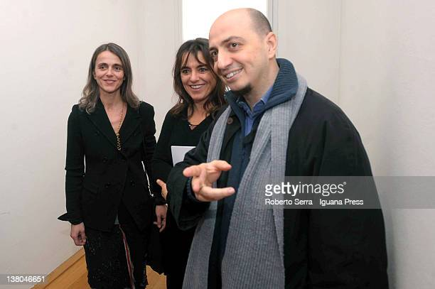 Cristina and Giuliana Pavarotti pose with curator Gianfranco Maraniello at Morandi Museum on February 1, 2012 in Bologna, Italy. Cristina and...