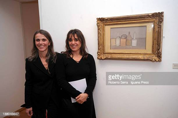 Cristina and Giuliana Pavarotti poses in front of their father Luciano's favourite picture at Morandi Museum on February 1, 2012 in Bologna, Italy....