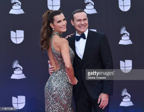 Cristina Bernal and Alan Tacher R attends the 20th annual Latin GRAMMY Awards at MGM Grand Garden Arena on November 14 2019 in Las Vegas Nevada