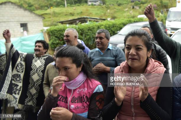 Cristina Carapaz celebrates after her brother Ecuadorean cyclist Richard Carapaz won the Giro d'Italia along with friends and other residents of...