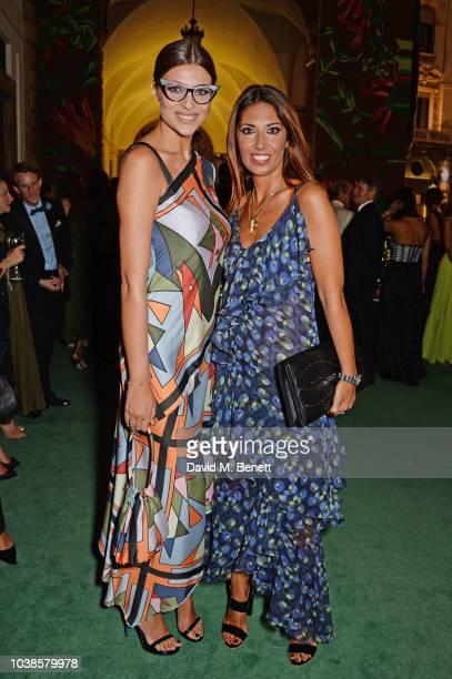 Cristina Chiabotto, wearing Laura Biagiotti, and Lavinia Biagiotti attend The Green Carpet Fashion Awards Italia 2018 at Teatro Alla Scala on...