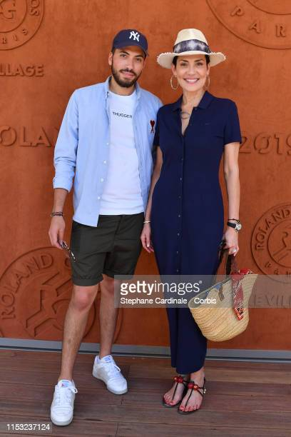 Cristina Cordula and her son Enzo attend the 2019 French Tennis Open - Day Eight at Roland Garros on June 02, 2019 in Paris, France.