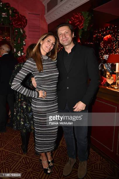 Cristina Cuomo and Boris Talan attend Anne Hearst McInerney Jay McInerney and George Farias Host Christmas Cheer at Doubles Club on December 13 2019...