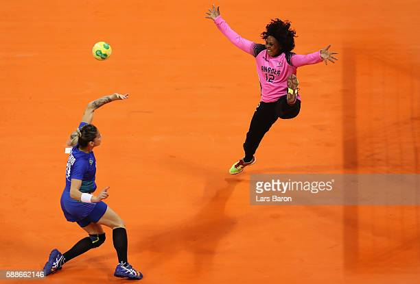 Cristina Direito Branco of Angola tries to save Angola shot of Jessica Quintino of Brazil during the Womens Preliminary Group A match between Angola...