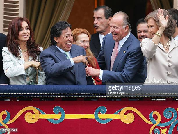 Cristina Fernandez wife of Argentine President Nestor Kirchner looks on as Peruvian President Alejandro Toledo jokes with Spanish King Juan Carlos...