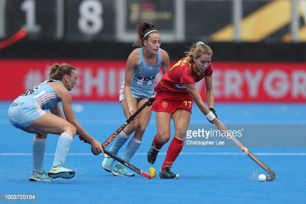 Cristina Guinea of Spain battles with Eugenia Trinchinetti and Florencia Habif of Argentina during the Pool C game between Argentina and Spain of the...