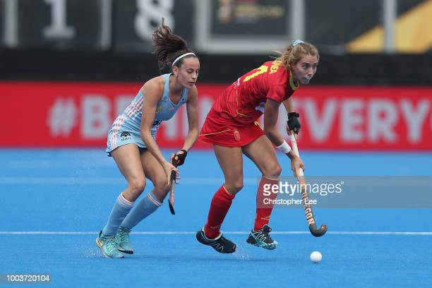 Cristina Guinea of Spain battles with Eugenia Trinchinetti of Argentina during the Pool C game between Argentina and Spain of the FIH Womens Hockey...