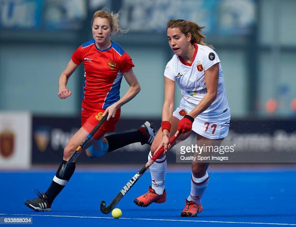Cristina Guinea of Spain competes for the ball with Irina Kuzmina of Russia during the match between Spain and Russia during day one of the Hockey...